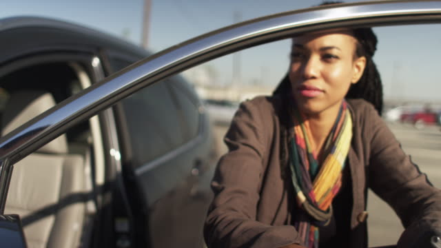 handheld shot of black woman talking to her friend and holding a cell phone - african american culture stock videos & royalty-free footage