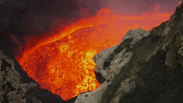 handheld shot of broiling lava - lava stock videos & royalty-free footage