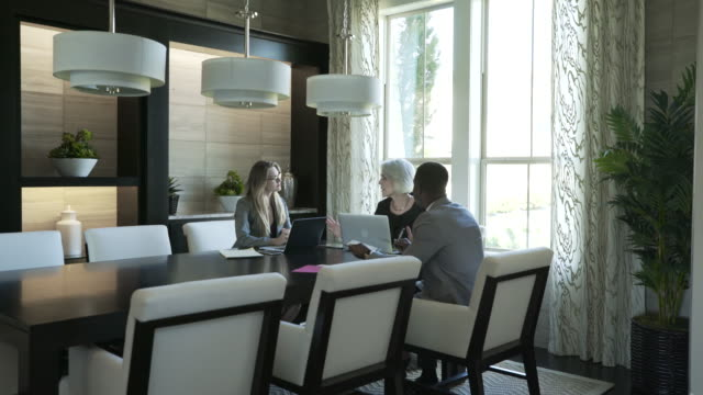 handheld shot of business people discussing in meeting at board room - pendant light stock videos & royalty-free footage