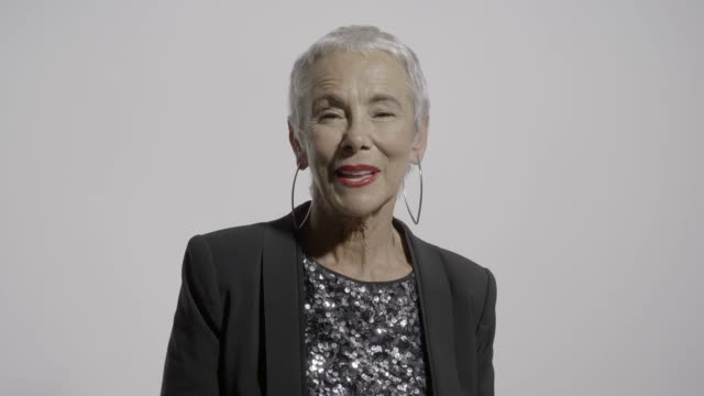 stockvideo's en b-roll-footage met handheld shot of cheerful retired senior woman - formeel portret