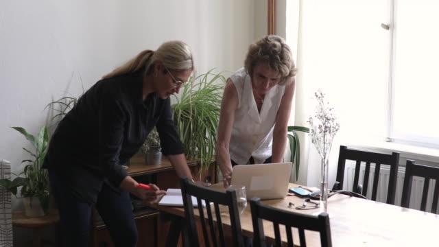Handheld shot of design professionals working together at home