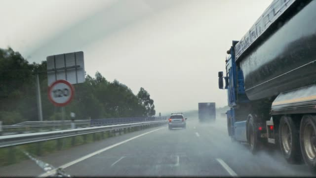 handheld shot of driving view from car windshield while raining on a highway - car point of view stock videos & royalty-free footage