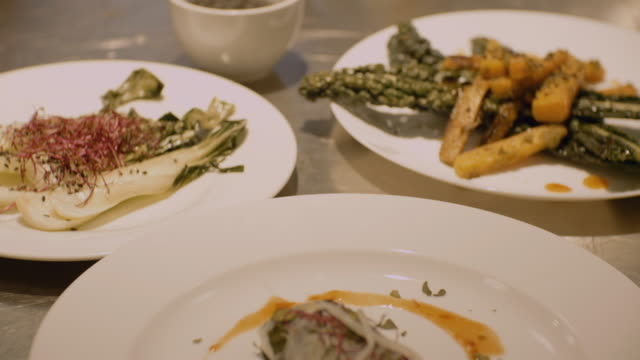 handheld shot of food in plates at restaurant - food styling stock videos & royalty-free footage