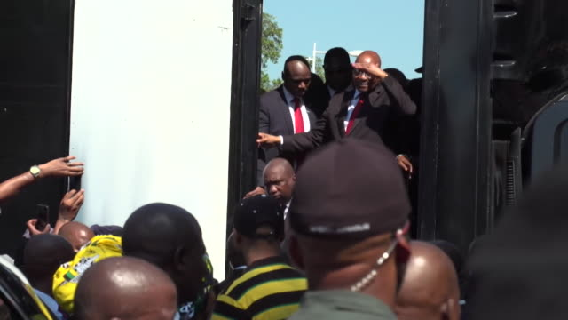 Handheld shot of Jacob Zuma leaving a rally outside Durban High Court KwaZuluNatal