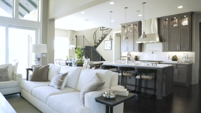 handheld shot of living room and kitchen - pendant light stock videos & royalty-free footage