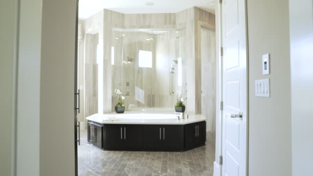handheld shot of modern bathroom - bathtub stock videos & royalty-free footage