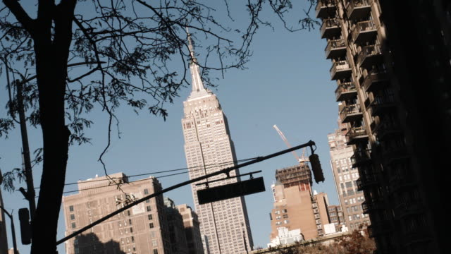 Handheld shot of New York City's Empire State Building on a warm Autumn afternoon