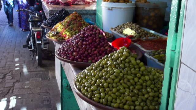 Handheld shot of olives for sale in a souk in Marrakesh