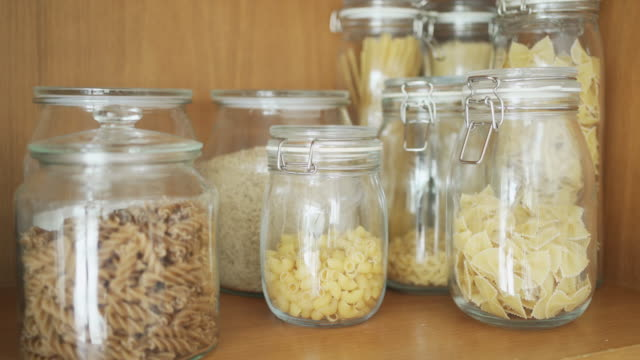 handheld shot of pasta in bottle - domestic kitchen stock videos & royalty-free footage