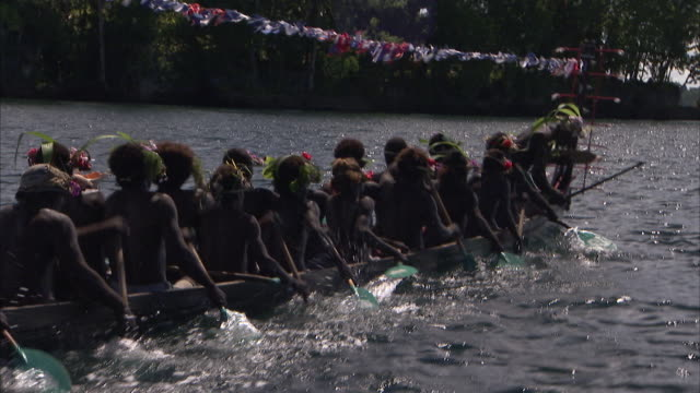 handheld shot of tribal people rowing longboat - viking stock videos and b-roll footage