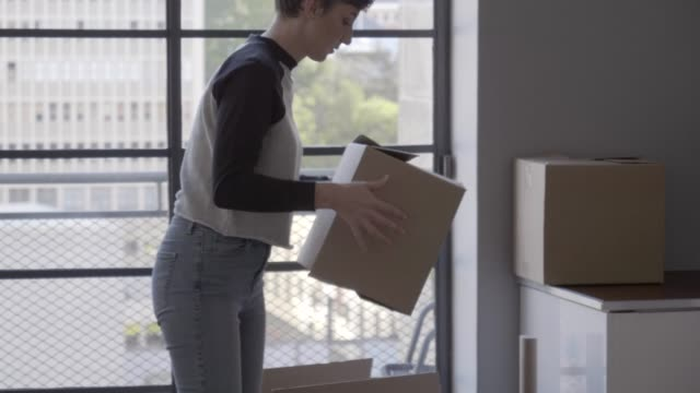 handheld shot of woman carrying cardboard box - moving house stock videos & royalty-free footage