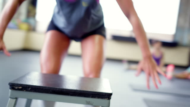 handheld shot of woman jumping on stool at gym - stool stock videos & royalty-free footage