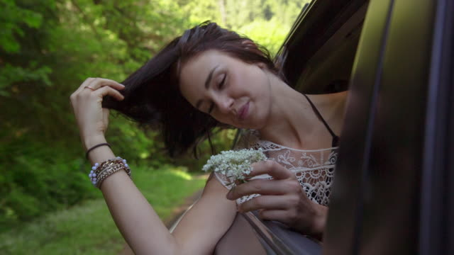 handheld shot of woman leaning on car window - smelling stock videos & royalty-free footage