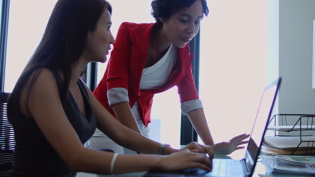 handheld shot of women working together - employee engagement stock videos & royalty-free footage