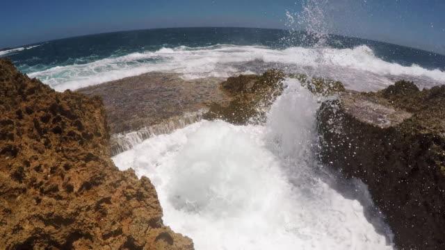 stockvideo's en b-roll-footage met handheld shot showing a coastal blowhole, carnarvon, western australia, australia - spuitgat
