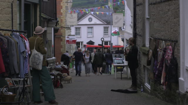 handheld shot showing a pedestrianised street in hayonwye powys wales rushes taken from bbccom/culture ww absa734n - powys stock videos & royalty-free footage