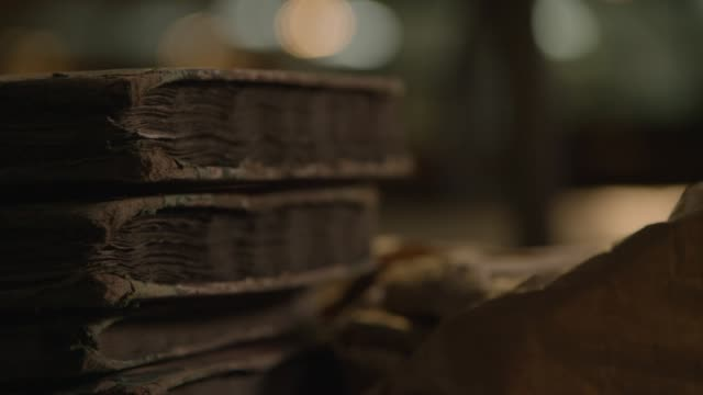 cu handheld shot stack of old ledgers - 19th century style stock videos & royalty-free footage
