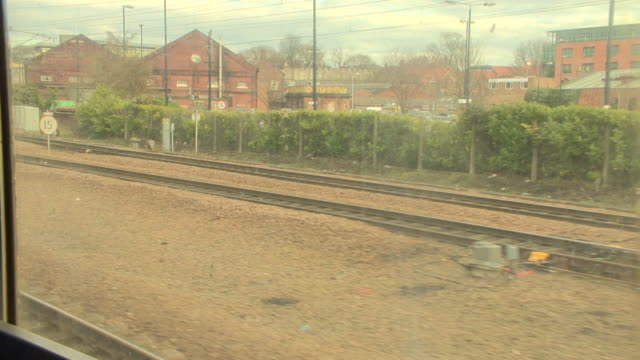 handheld shot taken from the carriage of the flying scotsman of the entry into york train station - railway station stock videos & royalty-free footage