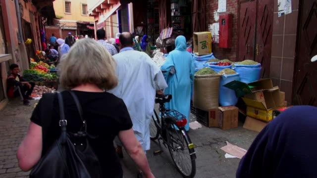 Handheld POV shot walking through a souk in Marrakesh