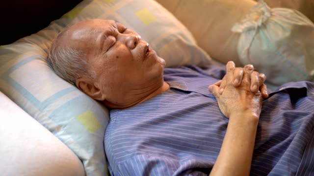 handheld sick old man on bed at home - sad old asian man stock videos & royalty-free footage