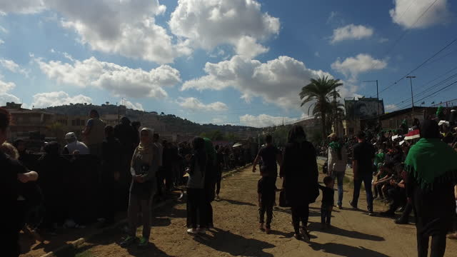 handheld through the shia muslim audience watching a reenactment of the battle of kerbala during the ashura commemorations in nabatieh. ashura is the... - ashura muharram stock videos & royalty-free footage