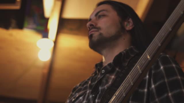 Handheld tilt A Latino bassist.