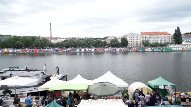 handheld view: Local market along Vitava river near Vyšehrad, Prague
