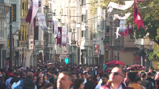 handheld view: pedestrian crowded on local street from taksim square under sunlight - istanbul province stock videos & royalty-free footage