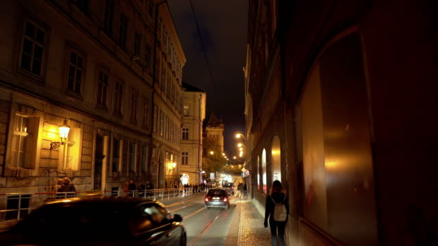 handheld view: walking in local street in prague at night - czech culture stock videos & royalty-free footage