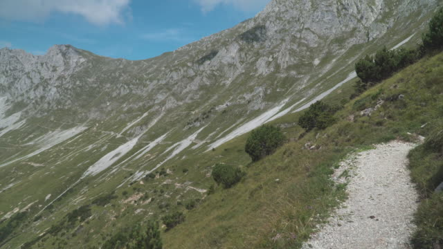 handheld view: walking on trail on slope of alps of austria in summer, hafelekarspitze-seegrube at karwendel mountain,innsbruck austria - footpath stock videos & royalty-free footage