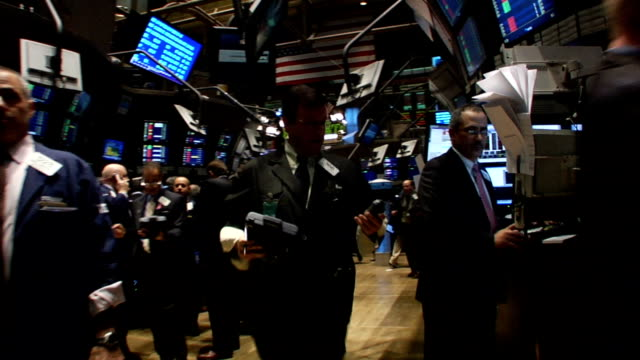 handheld waistlevel view walk through fastpaced traders and phone ringing on trading floor of new york stock exchange new york city - 2008 stock videos and b-roll footage