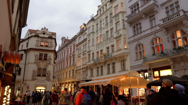 handheld walking view: in local luxury street and market in Prague at evening, Czech Republic