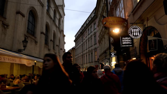handheld walking view: in local small street and market in Prague at evening, Czech Republic