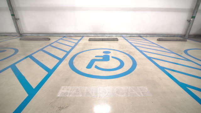 handicap parking space or disabled signs on parking lots - disability icon stock videos & royalty-free footage