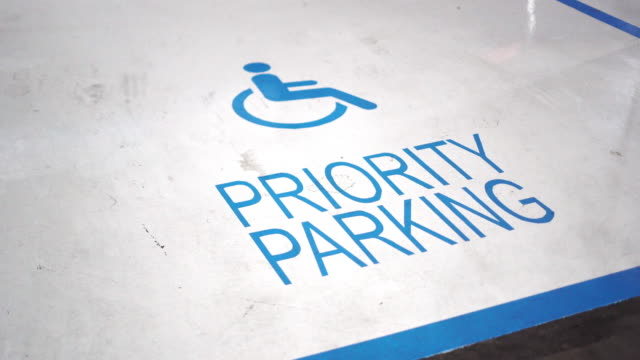 handicap parking space or disabled signs on parking lots - mode of transport stock videos & royalty-free footage