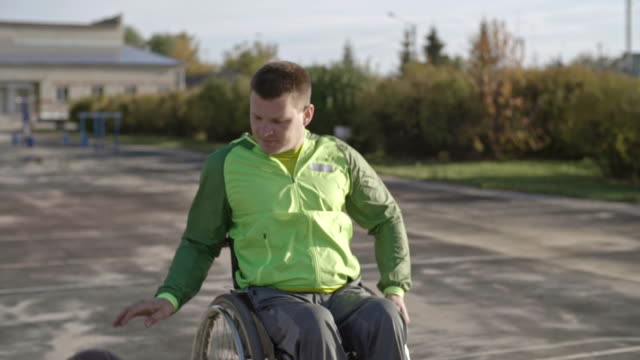 handicapped man dribbling and shooting basketball - wheelchair basketball stock videos and b-roll footage