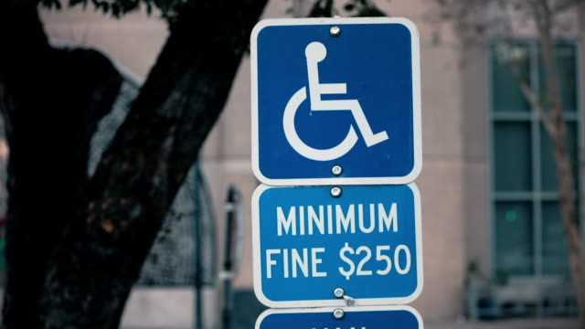 handicapped parking sign - disability icon stock videos & royalty-free footage