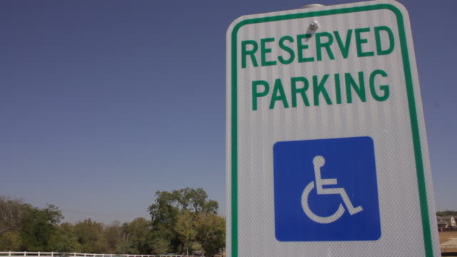 handicapped reserved parking sign - assistive technology stock videos & royalty-free footage
