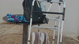 handicapped walking equipment under umbrella at the beach