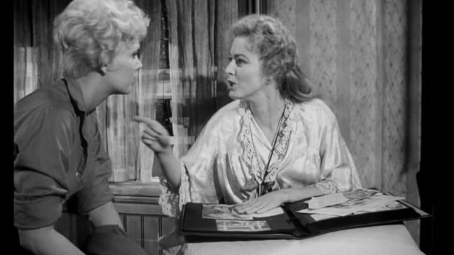 1955 Handicapped woman (Eleanor Parker) breaks down and threatens other woman (Kim Novak)