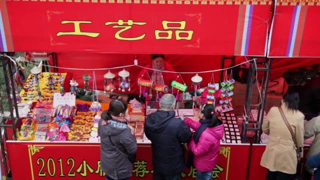 ms handicraft and mascot for sale at temple fair for celebrate chinese spring festival / xi'an, shaanxi, china - western script stock videos & royalty-free footage