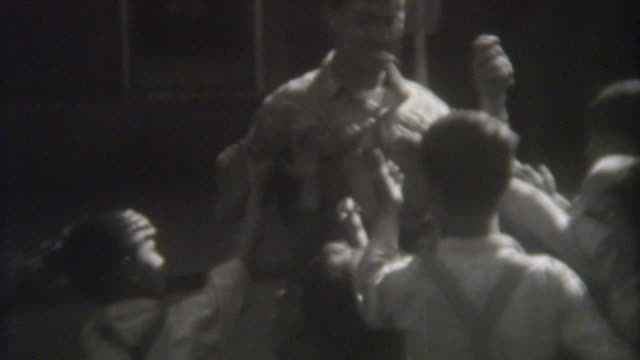 stockvideo's en b-roll-footage met handing out candy in austria 1944 - amerikaans strijdkrachten