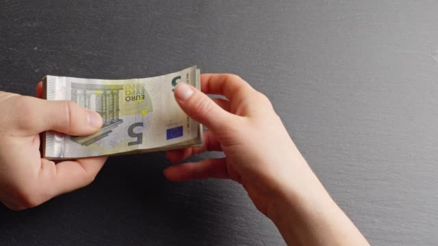 handing over five-euro-banknotes - euro symbol stock videos & royalty-free footage
