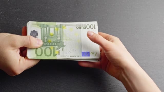 handing over ten-euro-banknotes - euro symbol stock videos & royalty-free footage