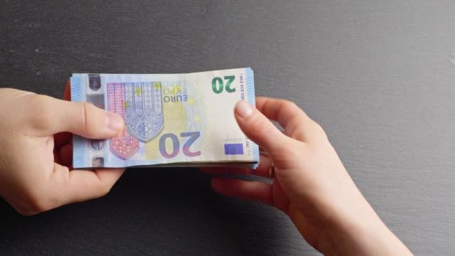 handing over twenty-euro-banknotes - euro symbol stock videos and b-roll footage