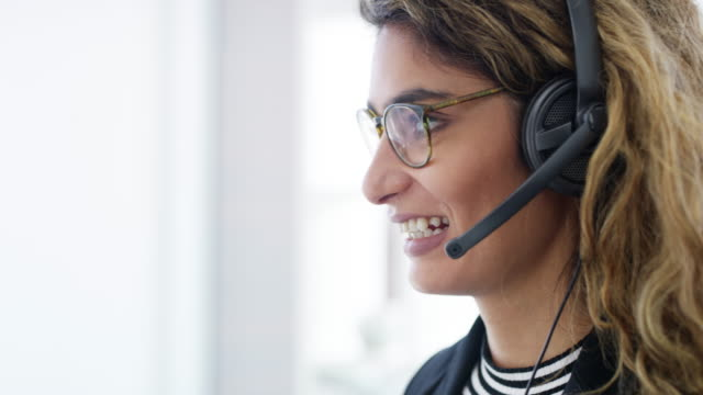 handling customer queries with utmost confidence - headset stock videos & royalty-free footage