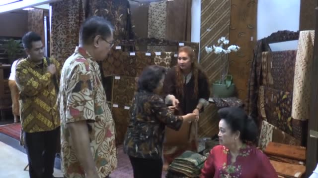 handmade batik clothes are exhibited at a local store as indonesians celebrate national batik day in jakarta indonesia on october 2 2014 batik's... - batik stock videos and b-roll footage