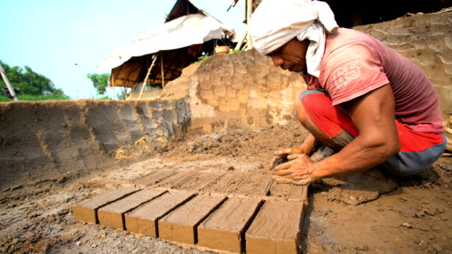 handmade bricks made by manual workers drying java - mud stock videos & royalty-free footage