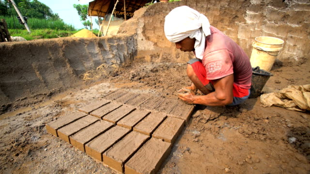 handmade bricks made by manual workers drying java - brick stock videos & royalty-free footage