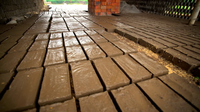 handmade bricks made by manual workers java indonesia - ziegel stock-videos und b-roll-filmmaterial